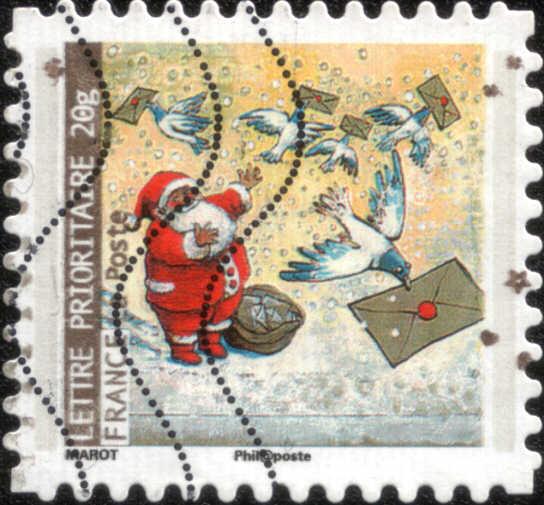 Timbre: Père Noël et pigeon transportant une lettre