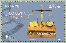 Timbre: Balance trébuchet