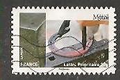 timbre: L'art et la matière-Métal-fer à cheval dans forge