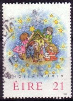 Timbre: Noël : enfants préparant la crèche