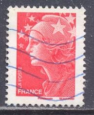 Timbre: Marianne de Beaujard rouge Dentelé, étoiles foncées